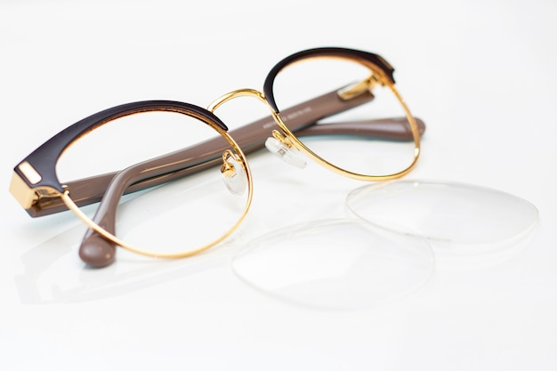 Modern fashionable womens glasses for sight. frame and glass on a light surface.