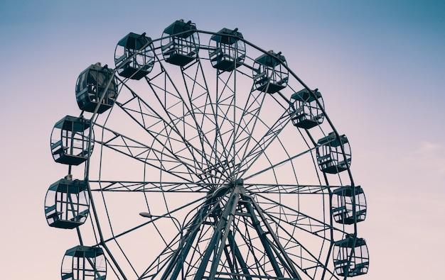 Modern ferris wheel against the sky, minimalistic plot