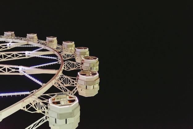 Modern ferris wheel at nighttime