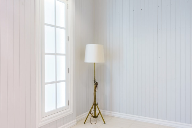 Modern floor lamp in upscale luxury home with white walls. scandinavian interior