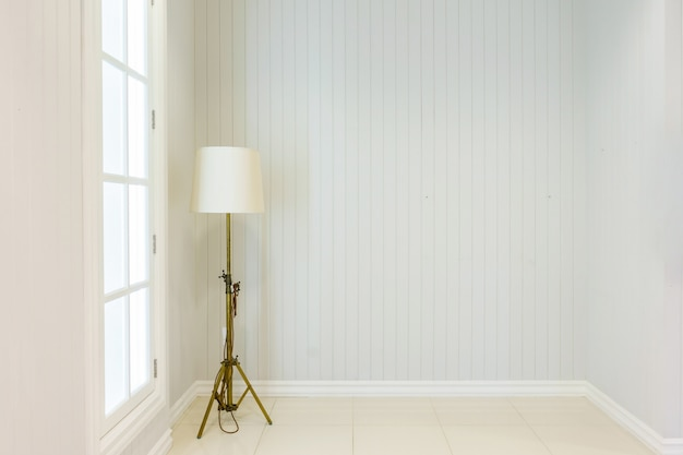 Modern floor lamp in upscale luxury home with white walls.