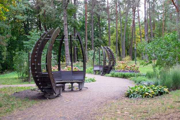 Modern gazebo outside. interesting bench for rest. park in forest
