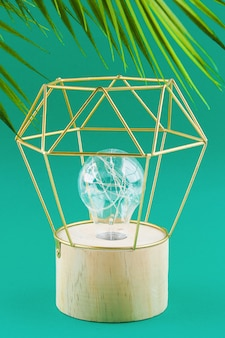 Modern geometric lamp with copper wire lampshade. metal frame of the lamp.