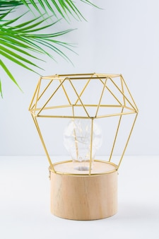 Modern geometric lamp with copper wire lampshade.