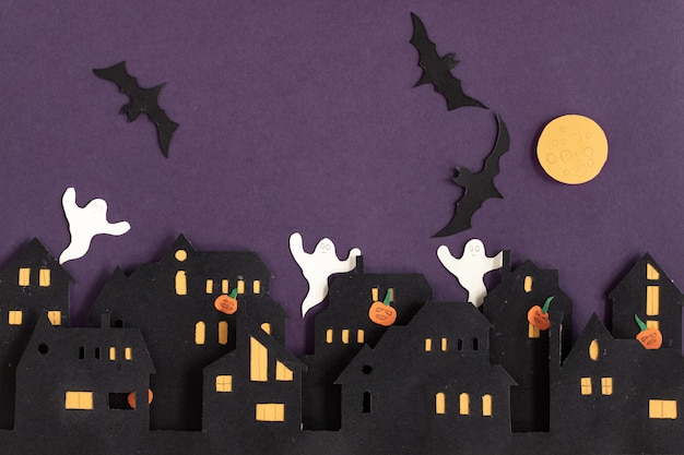 Modern gift card with halloween on dark background halloween in paper cut style