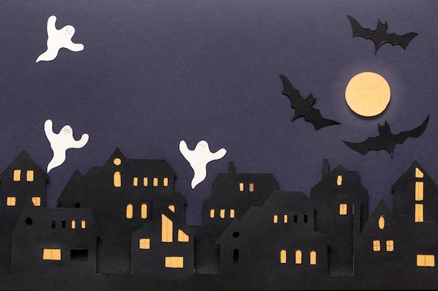 어두운 배경에 할로윈 현대 선물 카드입니다. 어두운 배경에 종이 컷 스타일의 헬로윈. 해피 할로윈.