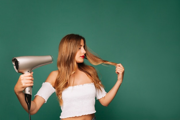 Modern girl with hairdryer
