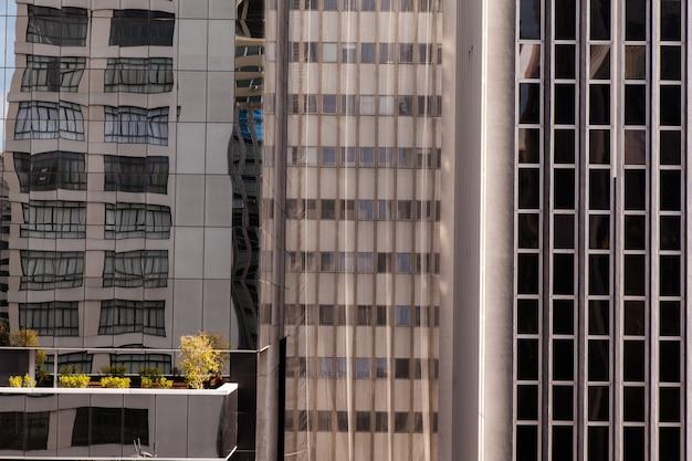 Modern glass windows in concrete building facade - urban modern architecture