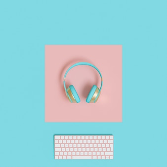 Modern gold and light blue audio headphones and computer keyboard on a two-color paper