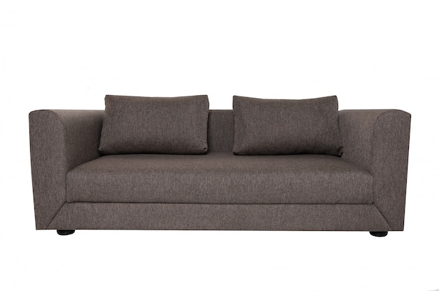 Modern grey fabric sofa with pillows isolated on white.