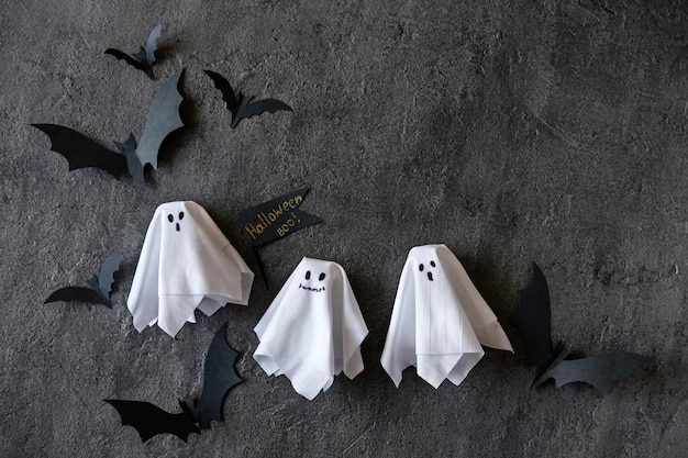 Modern halloween background with bats and ghosts on dark background