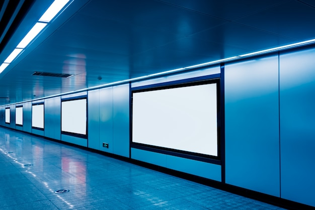 Modern hallway of airport or subway station with blank billboards