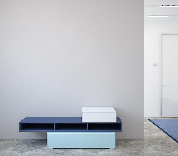 Современный интерьер прихожей с комодом у пустой серой стены