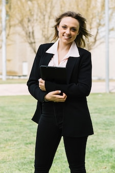 Modern and happy businesswoman outdoors