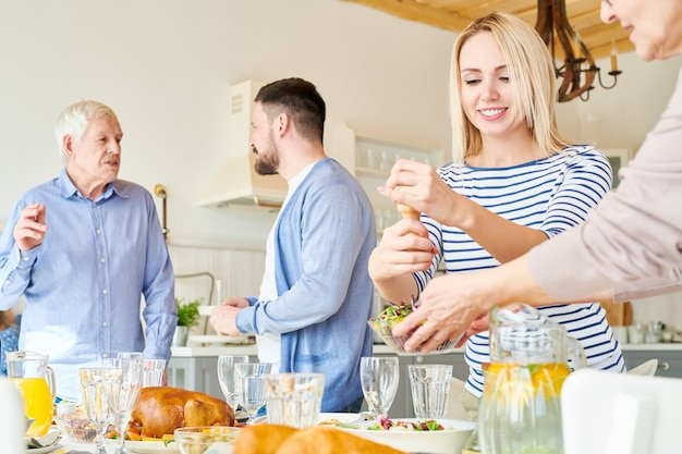 Modern happy family setting dinner table