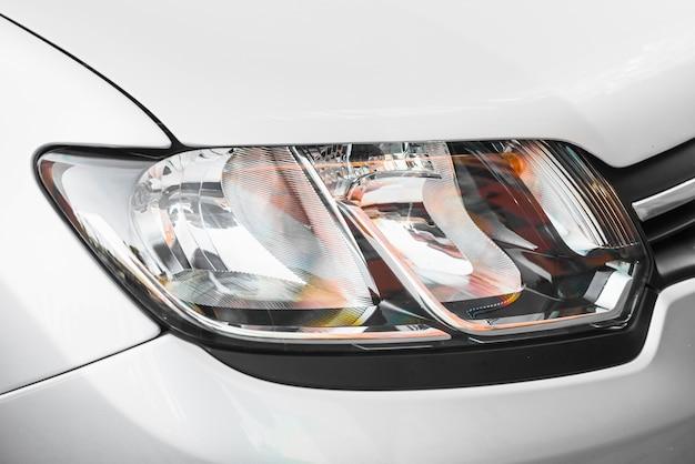 Modern headlight ofsilverautomobile