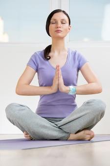 Modern healthy yoga woman wearing smart watch device