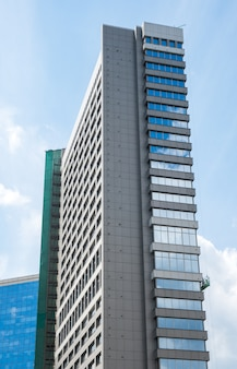 Modern high-rise building made of glass against the sky