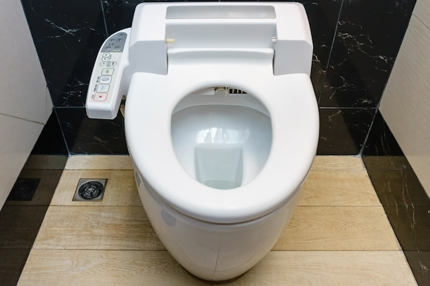 Modern high tech toilet with hygienic and high technology of the toilet bowl