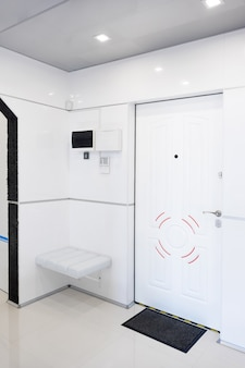 Modern home hallway interior. white plactic panels and tiles. futuristic interior concept design. space ship at home.