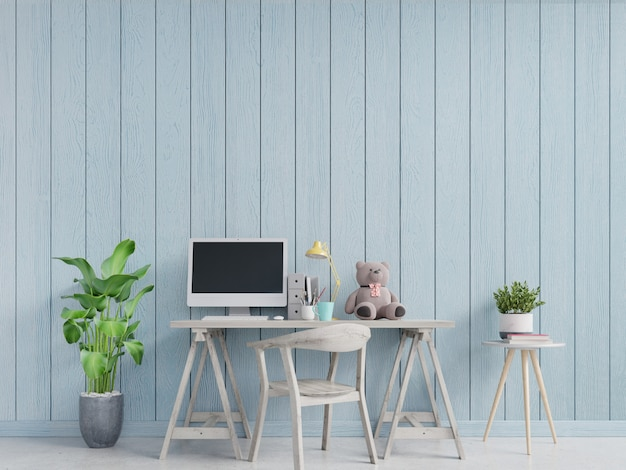Modern home office interior with blue walls decorated with teddy bear on table.