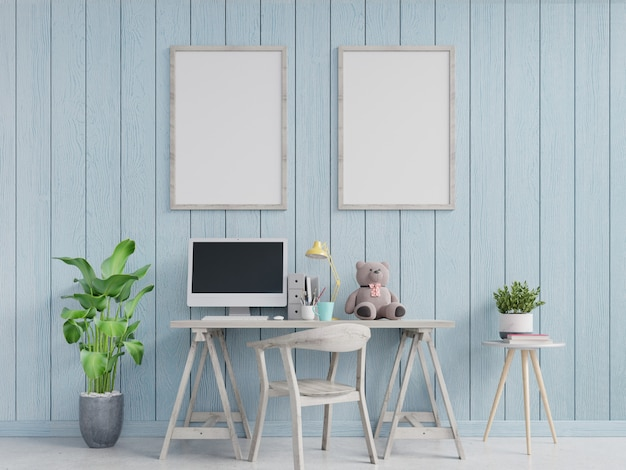 Modern home office interior with blue walls and a framed vertical poster. 3d rendering