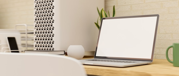 Modern home working space with laptop computer blank screen mockup on wooden table 3d rendering