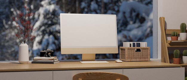 Modern home workspace in night winter, computer screen mockup with wooden desk closeup, cactus shelf, snow on tree from big window view, 3d rendering, 3d illustration