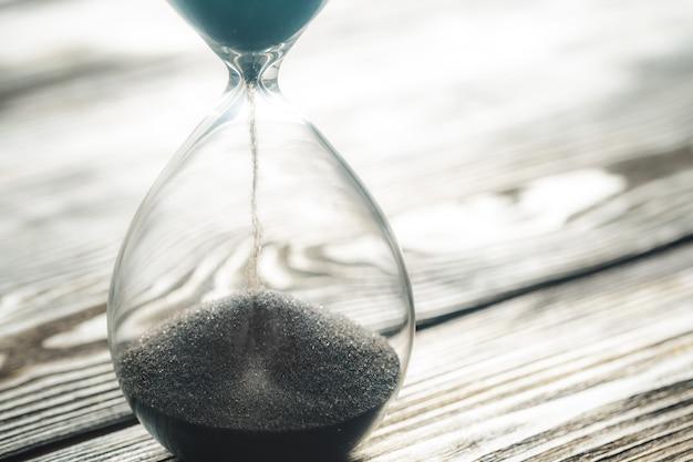 Modern hourglass on wood