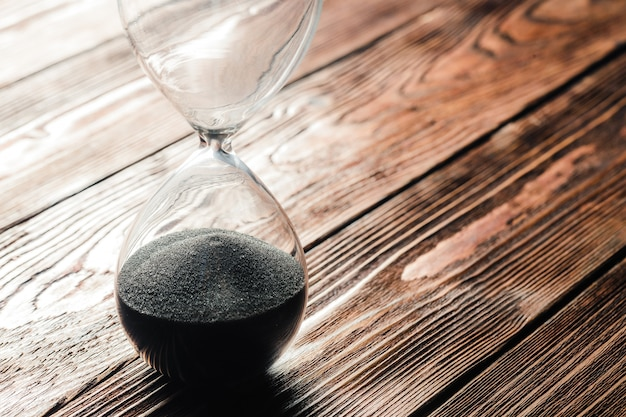 Modern hourglass on wooden