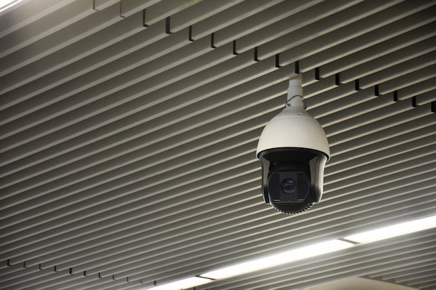 Modern indoors security cctv camera or surveillance system on ceiling