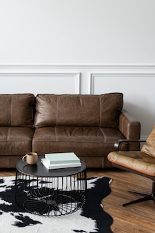 Modern industrial luxury style living room interior with leather couch and a coffee table