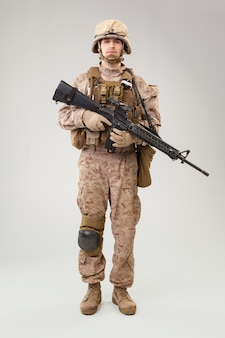 Modern infantry soldier, u.s. marine rifleman in combat uniform, helmet and body armor