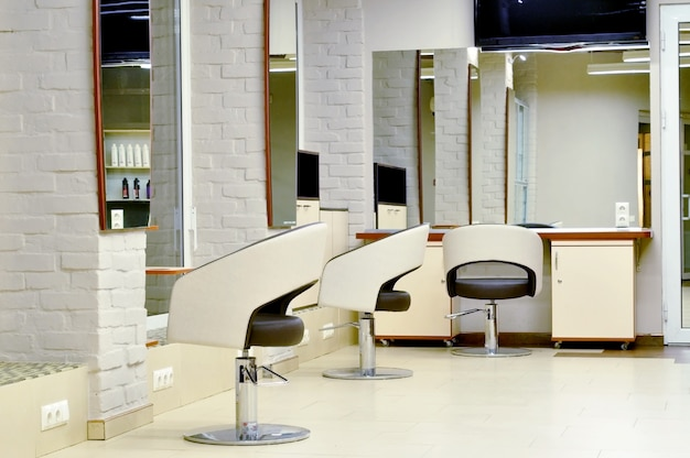 Modern interior of beauty salon and beauty specialist workplace. working space in a beauty salon for a hairdresser. interior of a hairdressing salon in light white beige colors