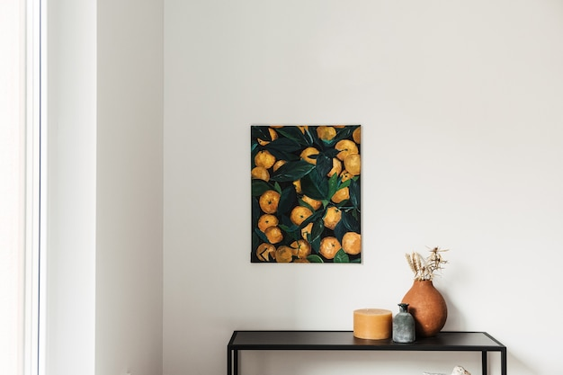 Modern interior design concept. oil painting canvas with oranges on the wall. candle, clay pot with dry plants.