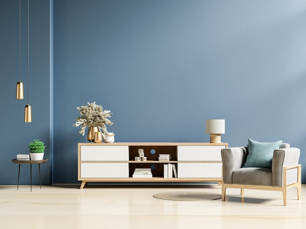Modern interior of living room with cabinet and armchair on dark blue wall