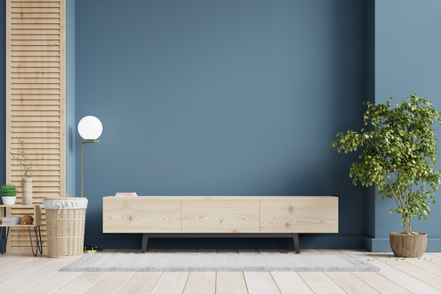 Modern interior of living room with cabinet for tv on dark blue wall