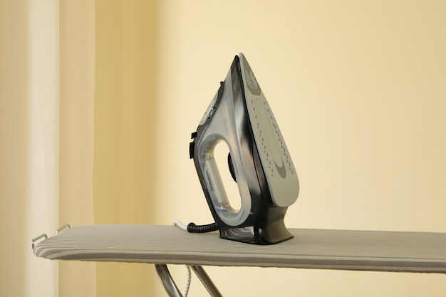 Modern iron on ironing board, space for text