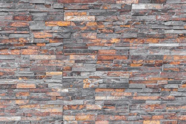 Modern irregular multi-color brick wall background.