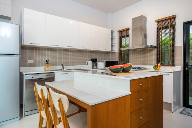 Modern kitchen feature island counter and appliance