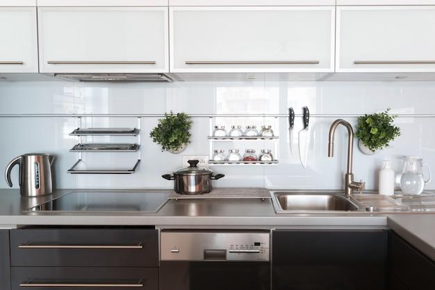 Modern kitchen at home with kitchenware