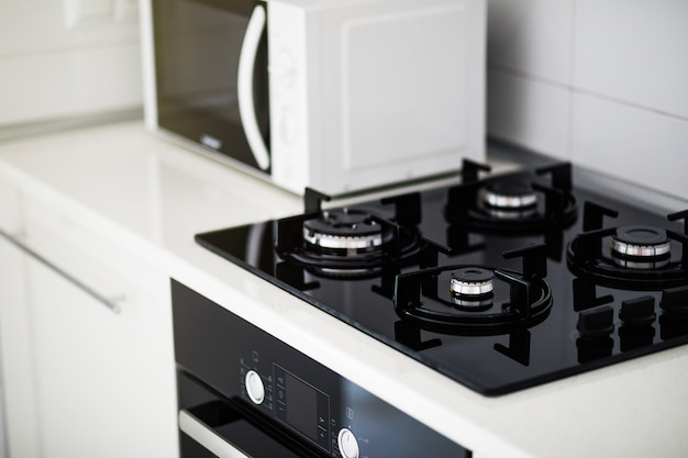 Modern kitchen interior with electric cooker and microwave oven