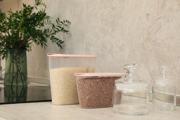 Modern kitchen interior with plastic containers with cereals