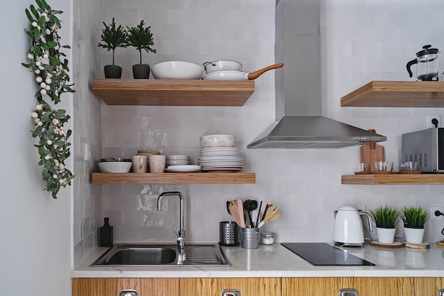 Modern kitchen interior with white brick tile wall in scandinavian style