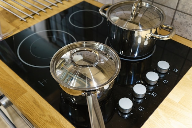 Modern kitchen pot cooking induction electrical stove hob concept
