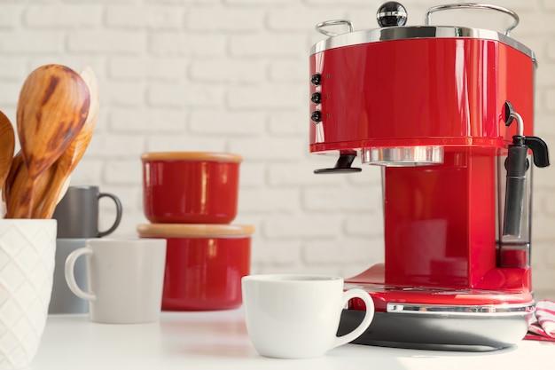 Modern kitchen, red retro style coffee machine close up
