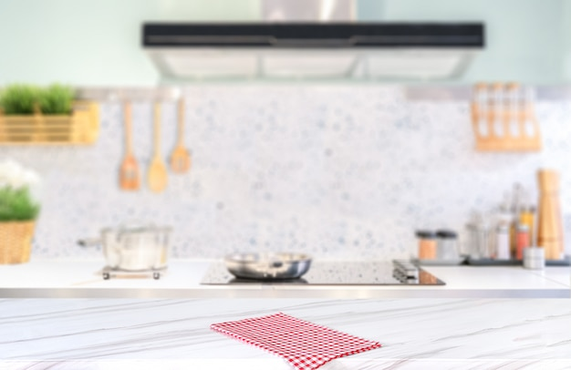 Modern kitchen with red checkered cloth