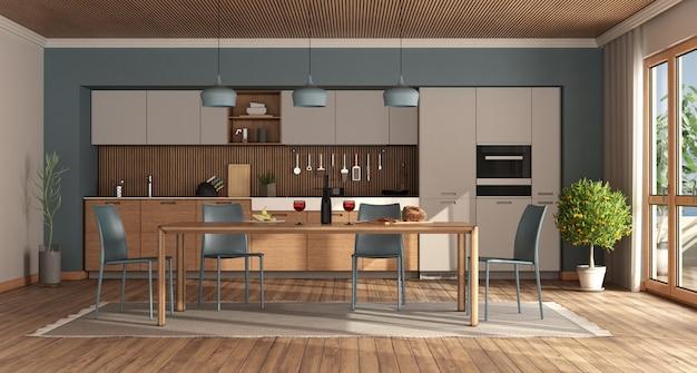 木製のテーブルと青い椅子のあるモダンなキッチン