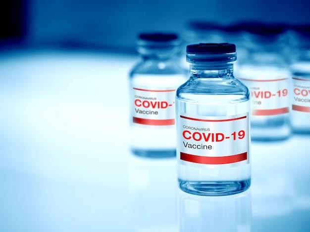 研究医療ラボのライトテーブルを照らすボトルバイアルの最新ラベルcovid19ワクチン