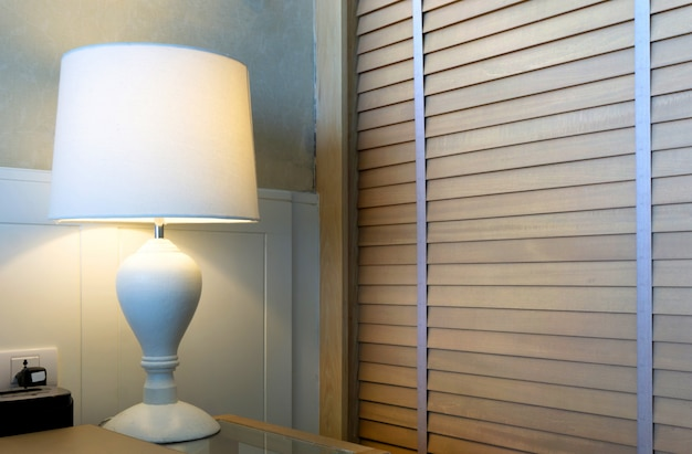 Modern lamp on table home interior bedroom setting bedside